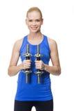 Femme s'exerçant avec des poids Photo stock