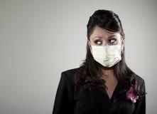 Femme s'usant un masque respiratoire Images stock