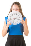 Femme se cachant derrière l'horloge Image stock