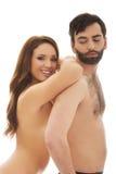 Femme se penchant sur le dos de l'homme Photos libres de droits
