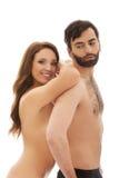 Femme se penchant sur le dos de l'homme Image stock