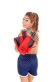 Femme se tenant avec des clous de girofle de boxe Image stock