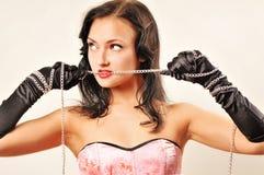 Femme sensuel dans le corsette rose Photographie stock libre de droits
