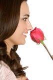 Femme sentant Rose Image libre de droits