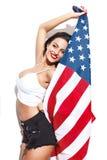 Femme sexy avec des gros seins tenant le drapeau des Etats-Unis Photo libre de droits