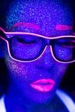 Femme sexy avec le maquillage fluorescent UV de visage et de corps Images libres de droits