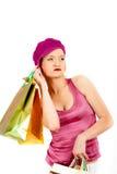 Femme sexy d'achats avec un bon nombre de sac multicolore Images stock