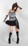Femme sexy dans le dessus de paillette et Mini Skirt Image stock
