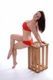 Femme sexy dans un maillot de bain rouge Images stock