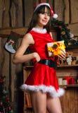 femme sexy de Claus Santa Photographie stock