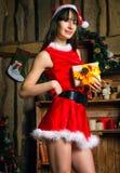 femme sexy de Claus Santa Images stock