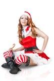 Femme sexy de Noël dans des vêtements du père noël Image libre de droits