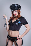 Femme sexy de police de beauté Image stock