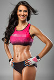 Femme sexy musculaire Photographie stock libre de droits