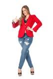Femme sexy occasionnelle dans le sourire rouge de manteau Photo stock