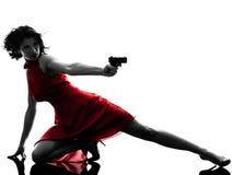 Femme sexy tenant la silhouette d'arme à feu Images stock