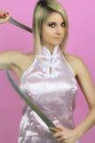 Femme sexy tenant une épée Image stock