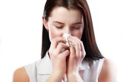 Femme soufflant son nez Image libre de droits