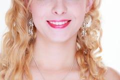 Femme souriant montrant les dents blanches Images stock
