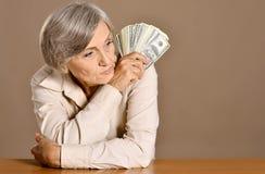 Femme supérieure avec l'argent Photo libre de droits