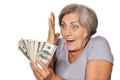 Femme supérieure avec l'argent Photo stock