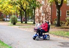 Femme supérieure avec le scooter 2 Image libre de droits