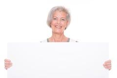 Femme supérieure avec le signe Images libres de droits