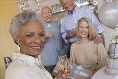 Femme supérieure avec le verre de Champagne Photographie stock libre de droits