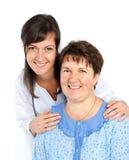 Femme supérieure avec son travailleur social  Photographie stock libre de droits