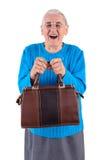 Femme supérieure tenant le sac Images stock