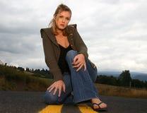 Femme sur la route Photo libre de droits