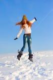 Femme sur le champ de neige Photographie stock