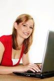 femme sur un ordinateur portatif Photographie stock