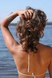 Femme sur une plage Images stock