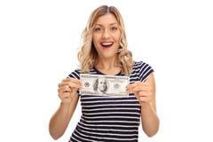 Femme tenant cent billets d'un dollar Photo libre de droits