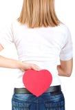 Femme tenant et montrant le symbole de foyer Photo libre de droits
