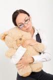 Femme tenant l'ours mol de jouet Photographie stock