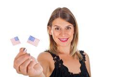 Femme tenant le drapeau des Etats-Unis Photos libres de droits