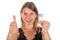 Femme tenant le drapeau des Etats-Unis Image libre de droits