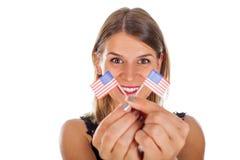 Femme tenant le drapeau des Etats-Unis Image stock