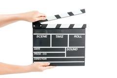 Femme tenant le panneau de clapet de production de film Image libre de droits
