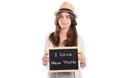 Femme tenant le tableau avec Photographie stock