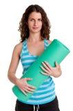 Femme tenant un tapis Photos stock