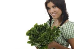 Femme tenant une salade verte d'endive Image stock