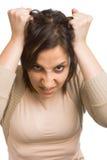 Femme tirant le cheveu Photographie stock libre de droits