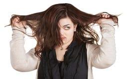 Femme tirant les cheveux malpropres Photo libre de droits