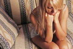 Femme triste Photographie stock libre de droits