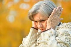 Femme triste avec le mal de tête Images libres de droits