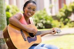 Femme trois de guitare Photo libre de droits