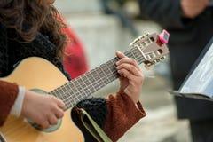 Femme trois de guitare Photographie stock libre de droits